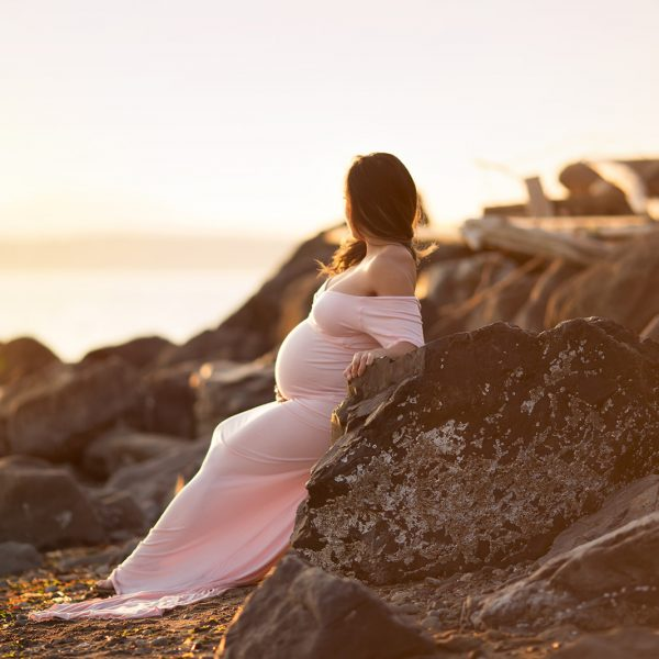 Off the shoulder, fitted maternity gown for rent