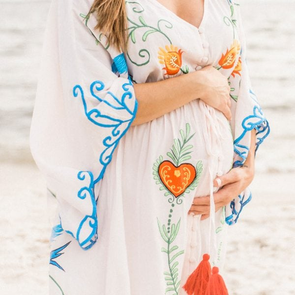 Rent this unique embroidered dress for an maternity special event