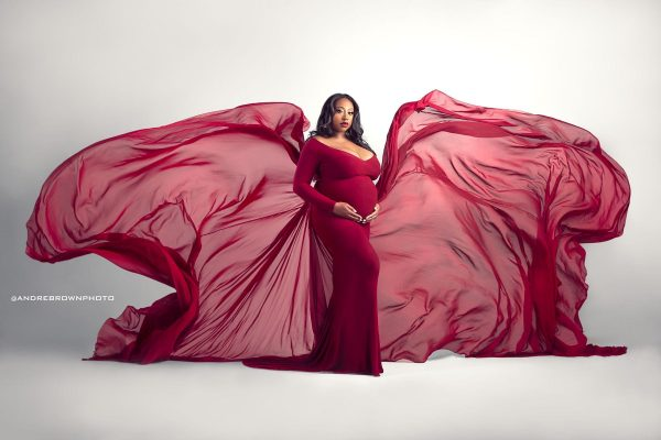 Ruby colored maternity dress photoshoot.