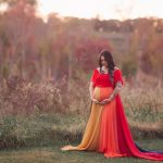 Rent this rainbow colored maternity gown